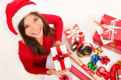 Christmas girl wrapping gifts
